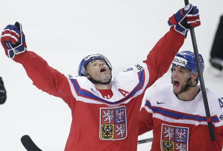 Czech Republic's Jaromir Jagr, left, celebrates with Michal Jordan, right, during the Hockey World Championships quarterfinal match in Prague, Czech Republic, Thursday, May 14, 2015. (AP Photo/Petr David Josek)