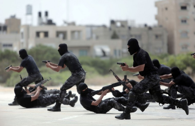 Palestinian Hamas security forces display their military skills during a police academy graduation ceremony in Gaza City, Thursday, May 21, 2015. (AP Photo/Khalil Hamra)