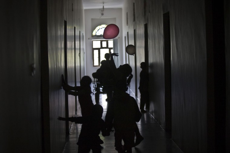 Girls play with balloons, inside a school where they are living with their displaced families who fled their home after a Saudi-led airstrike destroyed their houses, in Sanaa, Yemen, Thursday, May 14, 2015. The conflict in Yemen has killed more than 1,400 people — many of them civilians — since March 19, according to the U.N. The country of some 25 million people has endured shortages of food, water, medicine and electricity as a result of a Saudi-led blockade. (AP Photo/Hani Mohammed)