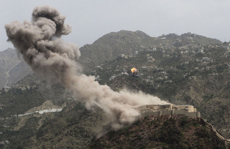 Smoke rises from al-Qahira castle, an ancient fortress that was recently taken over by Shiite rebels, as another building on the Saber mountain, in the background, explodes after Saudi-led airstrikes in Taiz city, Yemen, Thursday, May 21, 2015. Peace talks on Yemen will begin next week in Geneva, the U.N. announced Wednesday, as the international community tries to end weeks of Saudi-led airstrikes against an Iran-supported rebel group and a growing humanitarian crisis that has left millions short of food and fuel. (AP Photo/Abdulnasser Alseddik)