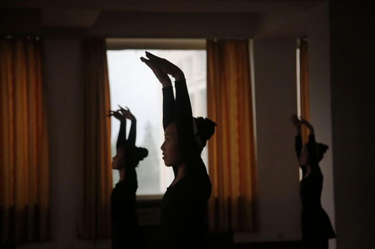 School girls are silhouetted during a dance class, Thursday, May 7, 2015, in Pyongyang, North Korea. The Pyongyang School Children's Palace is a place where talented school children go for extracurricular classes, and is one of the places tourists visit during their stay in Pyongyang. (AP Photo/Wong Maye-E)