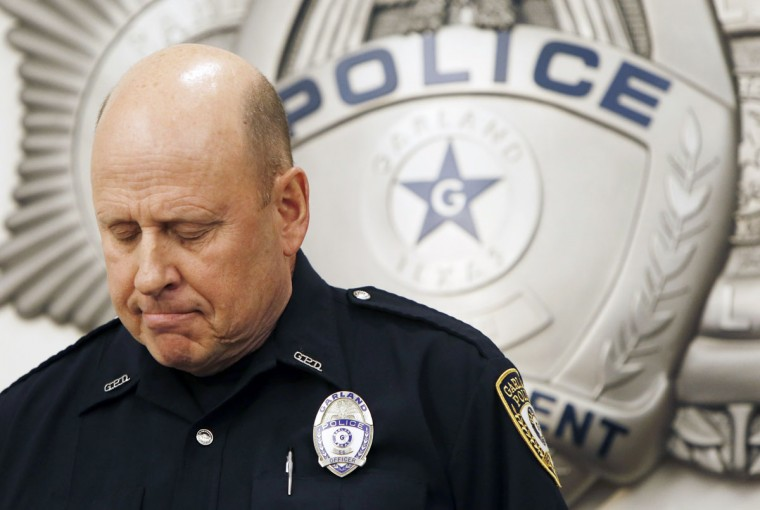 Garland Police spokesperson Joe Harn addresses the media during a news conference at the Garland Police Department, Monday, May 4, 2015, in Garland, Texas. Police shot and killed two men after they opened fire on a security officer outside the Curtis Caldwell Center in Garland, which was hosting provocative contest for Prophet Muhammad cartoons Sunday night, authorities said. (AP Photo/Brandon Wade)
