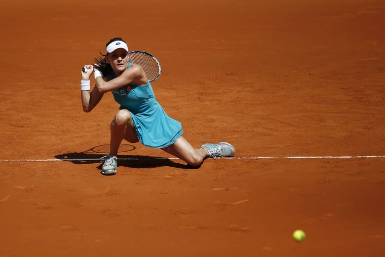 Agnieszka Radwanska from Poland returns the ball during her Madrid Open tennis tournament match against Casey Dellacqua from Australia in Madrid, Spain, Monday, May 4, 2015. (AP Photo/Andres Kudacki)