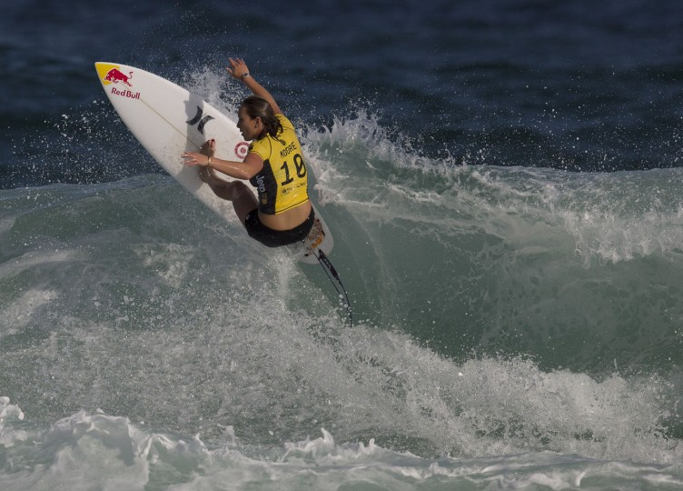 Hawaiian surfer Carissa Moore competes in the first round of the 2015 Oi Rio Pro World Surf League competition at Barra da Tijuca beach in Rio de Janeiro, Brazil, Tuesday, May 12, 2015. (AP Photo/Leo Correa)