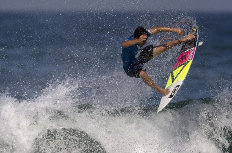Brazil's Italo Ferreira competes in the 2015 Oi Rio Pro World Surf League competition at Barra da Tijuca beach in Rio de Janeiro, Brazil, Tuesday, May 12, 2015. (AP Photo/Leo Correa)