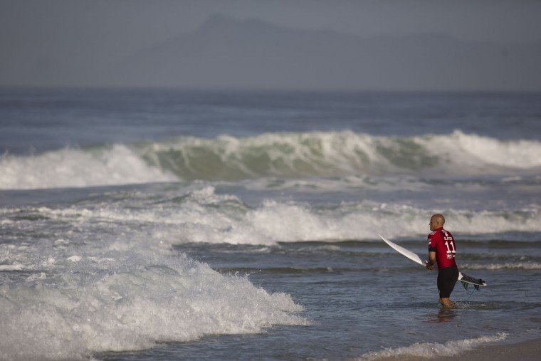 U.S. surfer Kelly Slater enters the waters to compete in the 2015 Oi Rio Pro World Surf League competition at Barra da Tijuca beach in Rio de Janeiro, Brazil, Tuesday, May 12, 2015. (AP Photo/Leo Correa)
