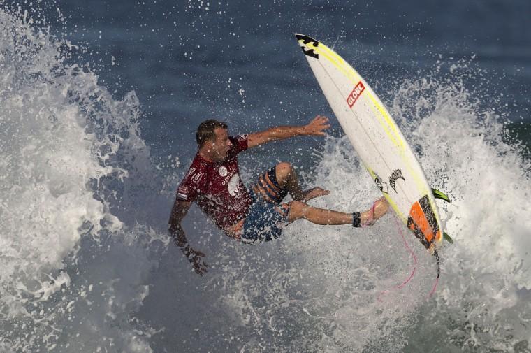 Australia's Taj Burrow competes in the 2015 Oi Rio Pro World Surf League competition at Barra da Tijuca beach in Rio de Janeiro, Brazil, Tuesday, May 12, 2015. (AP Photo/Leo Correa)