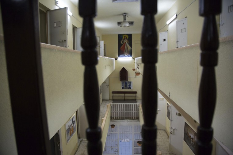 In this April 14, 2015 photo, a poster of Jesus hangs in the now empty Garcia Moreno Prison, during a guided tour for the public in Quito, Ecuador. After prisoners were transferred out in September, guides began giving 30 minute tours through the facility where tourists can get a first hand look at the cells where inmates slept, as well as the common areas. (AP Photo/Dolores Ochoa)