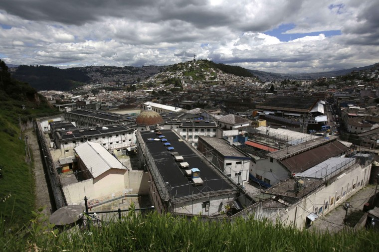 This April 9, 2015 photo shows the Garcia Moreno Prison, located in the middle of the capital city of Quito, Ecuador. The four-block-long building with numerous wings has been abandoned since September, when the 2,600 prisoners living in a space originally built for just 300 people were transferred to a larger and more modern penitentiary. (AP Photo/Dolores Ochoa)