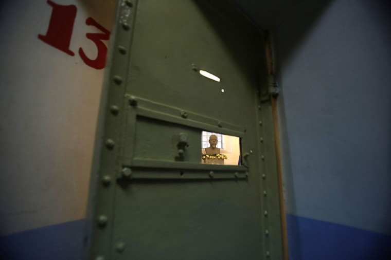 This April 7, 2015 photo shows a bust of Eloy Alfaro, who was Ecuador's president from 1897-1901 and again from 1906-1911, behind a jail cell at the now empty Garcia Moreno prison where he was imprisoned, during a guided tour for the public in Quito, Ecuador. Alfaro, one of the jail's most famous inmates who was imprisoned by his successor, was attacked in 1912 by a mob of civilians who broke into the jail and dragged his dead body outside and burned him in a public park. (AP Photo/Dolores Ochoa)