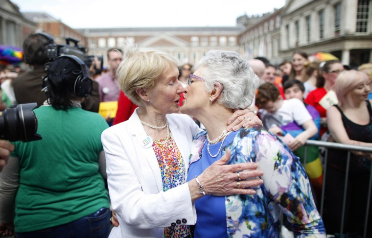 "Irish Senator Katherine Zappone, right, and partner Ann Louise Gilligan celebrate as the first results in the Irish referendum start to filter through at Dublin Castle, Ireland, Saturday, May 23, 2015. Ireland has voted resoundingly to legalize gay marriage in the world's first national vote on the issue, leaders on both sides of the Irish referendum declared Saturday even as official ballot counting continued. Senior figures from the ""no"" campaign, who sought to prevent Ireland's constitution from being amended to permit same-sex marriages, say the only question is how large the ""yes"" side's margin of victory will be from Friday's vote. (AP Photo/Peter Morrison)"