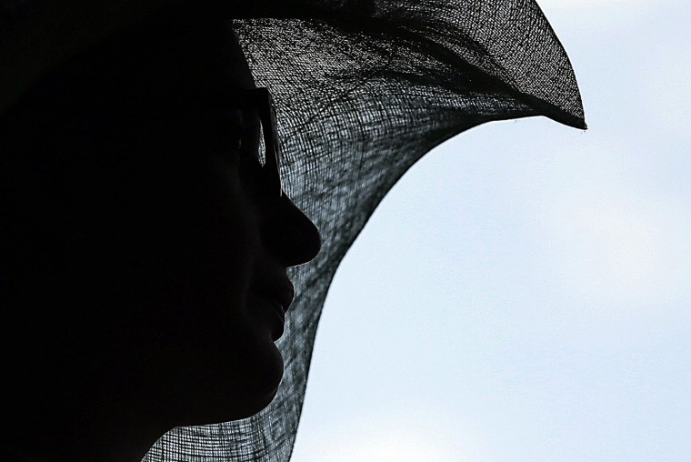 A fan wears a hat before the 141st running of the Kentucky Derby horse race at Churchill Downs Saturday, May 2, 2015, in Louisville, Ky. (AP Photo/Matt Slocum)
