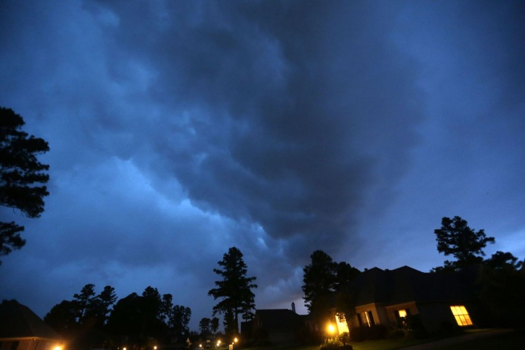A fast moving line of thunderstorms is seen from a neighborhood in Shreveport, La., Monday, May 25, 2015. Local news stations were reporting that a confirmed tornado moving at 50 miles per hour was approaching the area from Texas. (AP Photo/Gerald Herbert)