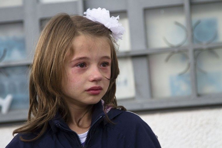 A girl weeps after she was evacuated safely from the scene of an altercation involving the police, in northern Macedonian town of Kumanovo, on Saturday, May 9, 2015. Authorities in Macedonia say police have clashed with an armed terrorist group in this northern Macedonian town, and parts of the town have been sealed off. Macedonia's state-run news agency MIA reported that four police officers were injured by gunfire, and three of them were taken to a hospital in the capital, Skopje. (AP Photo/Visar Kryeziu)