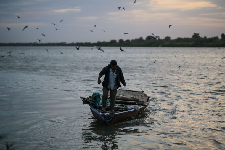 In this Thursday, April 16, 2015 photo, a Sudanese fisherman prepares to sail his boat at the start of the day at the Nile River, in Omdurman, Khartoum, Sudan. The river fishermen spend most of their days on the water; their four-long meter boats turn into temporarily homes. (AP Photo/Mosa'ab Elshamy)