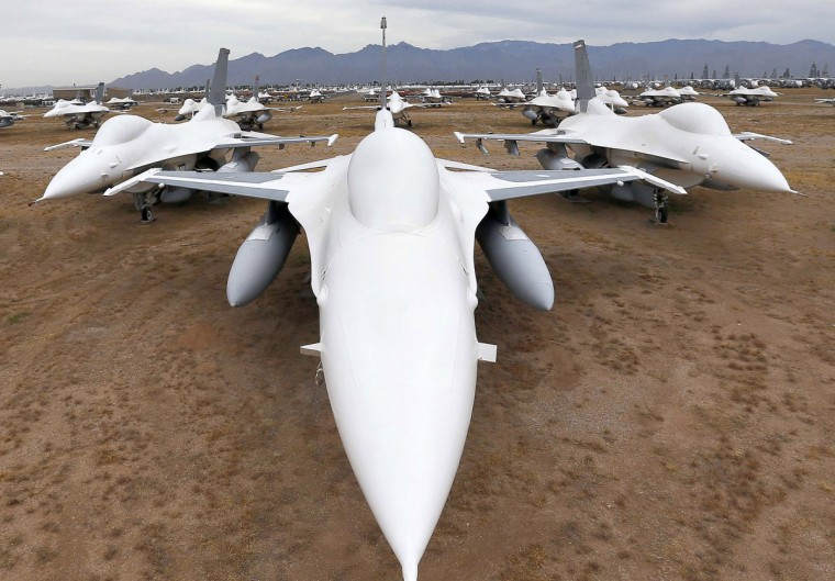 F-16 Fighting Falcons covered in sealing paint sit in a field along Miami St. at the 309th Aerospace Maintenance and Regeneration Group boneyard at Davis-Monthan Air Force Base in Tucson, Ariz., on Thursday, May 21, 2015. Over 4,500 variants of the F-16's have been produced since 1973. This field of fighters will become drone target planes in the future. (AP Photo/Matt York)