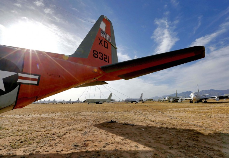 "U.S. Navy Lockheed LC-130, known as ""321"", which crashed in 1971 during a resupply mission in Antarctica, is shown at the 309th Aerospace Maintenance and Regeneration Group boneyard, Thursday, May 14, 2015 at Davis-Monthan Air Force Base in Tucson, Ariz. 321 stayed buried in snow up to it's tail fin in Antarctica for 17 years until crews were able to dig it out, repair it and return it to service. (AP Photo/Matt York)"