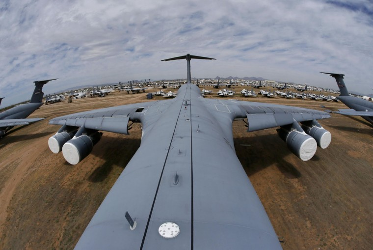 Fields of military aircraft can be seen from atop a Lockheed C-5 Galaxy cargo jet, as shown in this fisheye lens photograph, at the 309th Aerospace Maintenance and Regeneration Group boneyard Thursday, May 14, 2015 at Davis-Monthan Air Force Base in Tucson, Ariz. The C-5A Galaxy the largest aircraft in the U.S. armed services. (AP Photo/Matt York)
