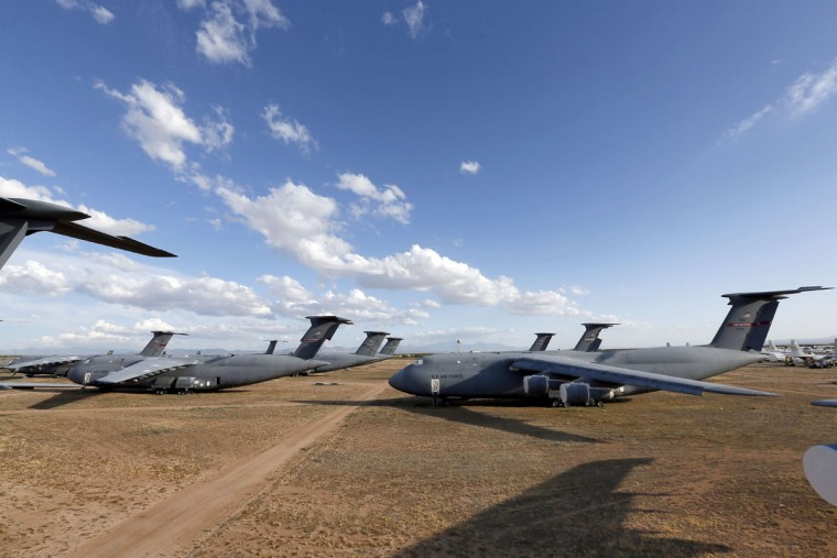 A field of Lockheed C-5 Galaxy cargo jets are shown at the 309th Aerospace Maintenance and Regeneration Group boneyard Thursday, May 14, 2015 at Davis-Monthan Air Force Base in Tucson, Ariz. The C-5A Galaxy the largest aircraft in the U.S. armed services. (AP Photo/Matt York)