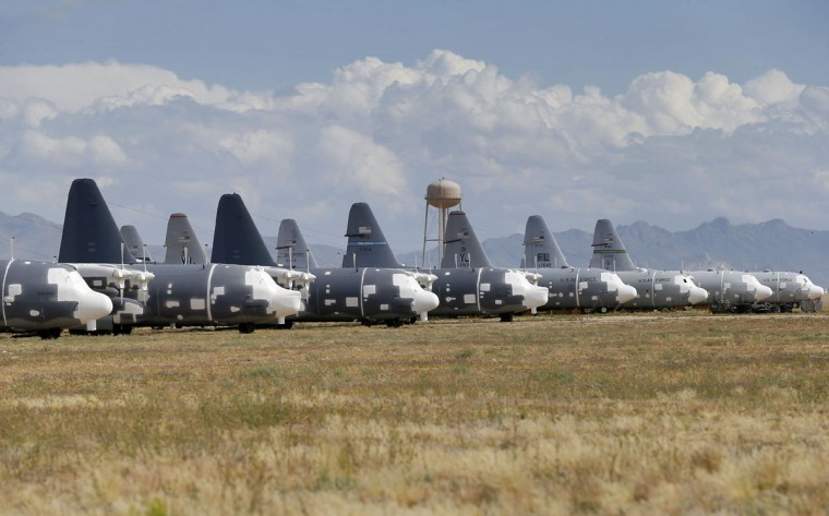 Air Force Lockheed MC-130H Hercules' are stored at the 309th Aerospace Maintenance and Regeneration Group boneyard, Thursday, May 14, 2015 at Davis-Monthan Air Force Base in Tucson, Ariz. (AP Photo/Matt York)