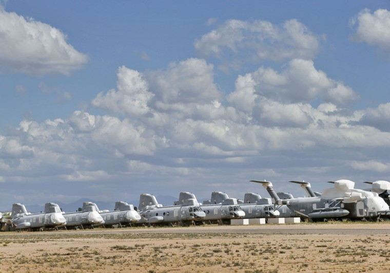 Boeing Vertol CH-46 Sea Knights are stored in a field at the 309th Aerospace Maintenance and Regeneration Group boneyard Thursday, May 14, 2015 at Davis-Monthan Air Force Base in Tucson, Ariz. (AP Photo/Matt York)