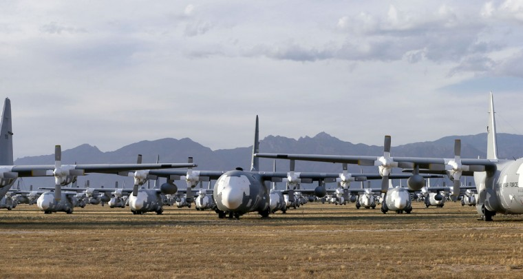 Numerous C-130 Hercules cargo planes are lined up in a field at the 309th Aerospace Maintenance and Regeneration Group boneyard Thursday, May 14, 2015 at Davis-Monthan Air Force Base in Tucson, Ariz. (AP Photo/Matt York)