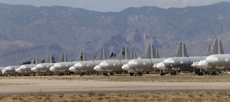 Lockheed P-3c Orions are stored at the 309th Aerospace Maintenance and Regeneration Group boneyard, Thursday, May 14, 2015 at Davis-Monthan Air Force Base in Tucson, Ariz. (AP Photo/Matt York)