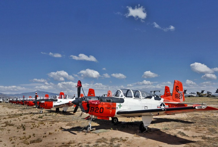 A row of U.S. Navy Beechcraft T-34 Mentor trainers are stored at the 309th Aerospace Maintenance and Regeneration Group boneyard, Thursday, May 14, 2015 at Davis-Monthan Air Force Base in Tucson, Ariz. (AP Photo/Matt York)