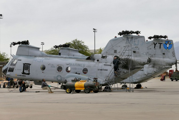 Crew from from the 309th Aerospace Maintenance and Regeneration Group boneyard prepare a pair of Boeing Vertol CH-46 Sea Knights for storage after their arrival, Friday, May 15, 2015 at Davis-Monthan Air Force Base in Tucson, Ariz. The 309th is the United States Air Forceís aircraft and missile storage and maintenance facility. AMARG provides long and short-term aircraft storage, parts reclamation and disposal. (AP Photo/Matt York)