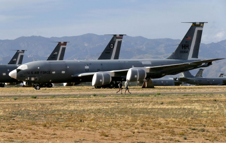 "309th Aerospace Maintenance and Regeneration Group employees walk past Boeing KC-135R Stratotankers at the boneyard, Thursday, May 14, 2015 at Davis-Monthan Air Force Base in Tucson, Ariz. The ""boneyard"" is worldís largest aircraft storage and preservation facility. (AP Photo/Matt York)"