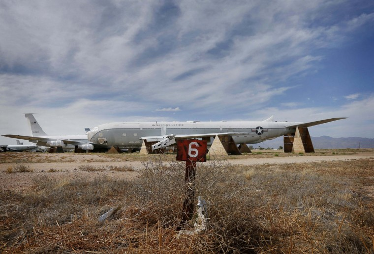 "In this photo taken on Thursday, May 14, 2015, the remains of a Boeing KC-135A Stratotanker, serial no. 55-3129, are stored at the 309th Aerospace Maintenance and Regeneration Group boneyard at Davis-Monthan Air Force Base in Tucson, Ariz. The aircraft is the original ""Weightless Wonder"" of NASA according to the planes' records. NASA used the aircraft to train the Mercury 7 astronauts on zero-gravity flights, and it was nicknamed the ""Vomit Comet"" for its effect on pilots and passengers alike. (AP Photo/Matt York)"