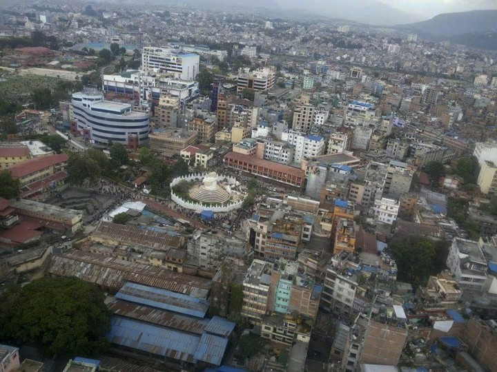 This aerial photo provided by Shreejan Bhandari, shows the historical Dharahara Tower, a city landmark, destroyed by Saturday's earthquake in Kathmandu, Nepal, Monday, April 27, 2015. A strong magnitude earthquake shook Nepalís capital and the densely populated Kathmandu valley on Saturday devastating the region and leaving tens of thousands shell-shocked and sleeping in streets. (Shreejan Bhandari via AP)