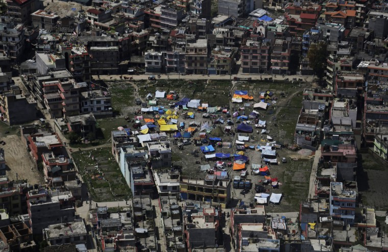 An aerial view of tents setup by residents in Kathmandu, Nepal, Monday, April 27, 2015. Shelter, fuel, food, medicine, power, news, workers ó Nepal's earthquake-hit capital was short on everything Monday as its people searched for lost loved ones, sorted through rubble for their belongings and struggled to provide for their families' needs. (AP Photo/Altaf Qadri)