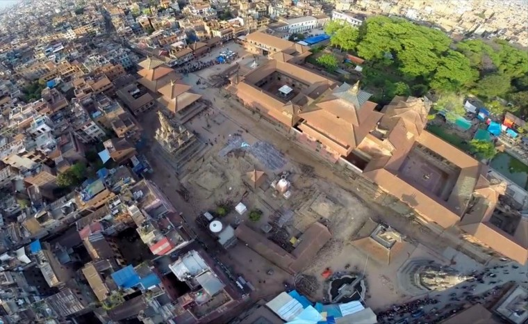 In this image made from drone video taken on Monday, April 27, 2015, an aerial view of damage caused by Saturday's earthquake in Patan Durbar Square, Kathmandu, Nepal. Helicopters crisscrossed the mountains above a remote district Tuesday, April 28, 2015 near the epicenter of the weekend earthquake in Nepal that killed more than 4,600 people, ferrying the injured and delivering emergency supplies. Officials said 250 villagers were feared missing in a new mudslide. (AP Photo/Casey Allred/Effect.org)