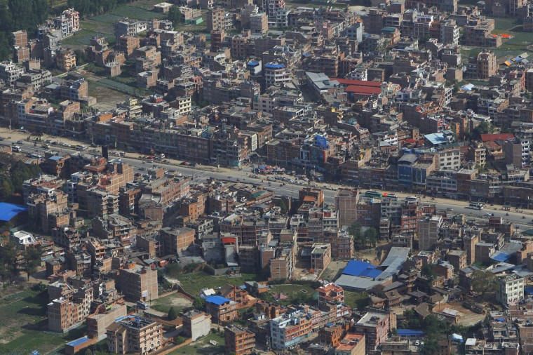 Buildings in Kathmandu stand six days after the April 25 massive earthquake in Nepal Friday, May 1, 2015. Kit Miyamoto, the structural engineer touring Kathmandu, called the damage in the capital, and the possibility that aftershocks could cause much more, a wakeup call. The government and outside nations should begin work to strengthen existing buildings and construct stronger new ones. (AP Photo/Niranjan Shrestha)