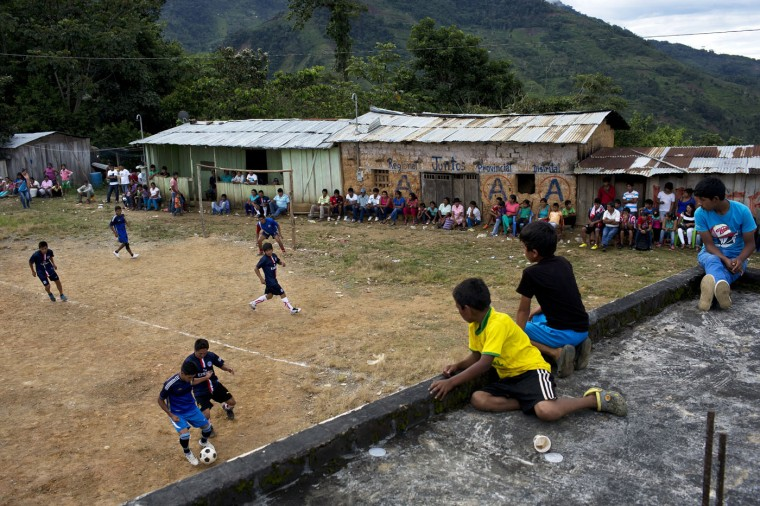 In this March 15, 2015 photo, young men compete in a multi-village soccer tournament, in La Mar, province of Ayacucho, Peru. A hardy lot, cocaine backpackers are mostly native Quechua speakers and hail from the isolated communities that suffered the worst atrocities of Peruís 1980-2000 dirty war with Shining Path rebels. (AP Photo/Rodrigo Abd)