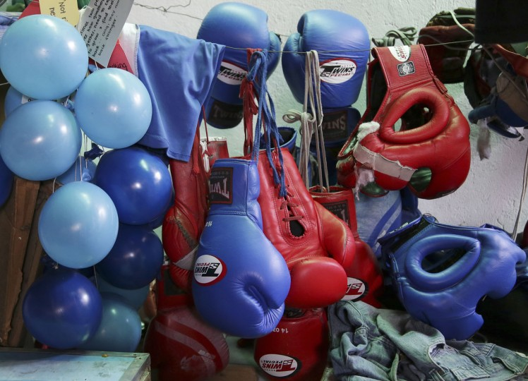 In this April 22, 2015, photo, boxing equipment hangs at a dormitory where young Filipino boxers stay during training in suburban Paranaque, south of Manila, Philippines. Manny Pacquiao's rise from crushing poverty to global fame and fortune has inspired a whole generation of Filipino fighters, who look up to his legend as their dream and boxing as a ticket out of harsh lives and uncertainties. (AP Photo/Aaron Favila)