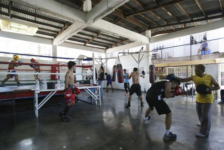 In this April 22, 2015, photo, Filipino boxers train at a boxing gym in suburban Paranaque, south of Manila, Philippines. The popularity of boxing in the Philippines has risen lately due, in part, to Filipino boxing icon Manny Pacquiao. (AP Photo/Aaron Favila)