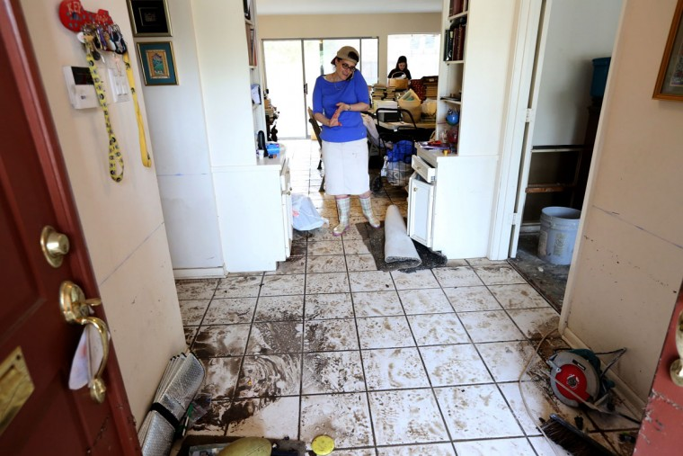 Gabrielle Gelman, wife of Rabbi Barry Gelman, stands in their home that suffered extensive flood damage in the recent storms, Wednesday, May 27, 2015, in Houston, Texas. Rabbi Gelman's home is across the street from the United Orthodox Synagogues of Houston, which also had major flood damage. More rain fell on the hard-hit Houston area, threatening to complicate the cleanup a day after a downpour of nearly a foot triggered some of the worst flooding Houston has ever seen. (Gary Coronado/Houston Chronicle via AP)