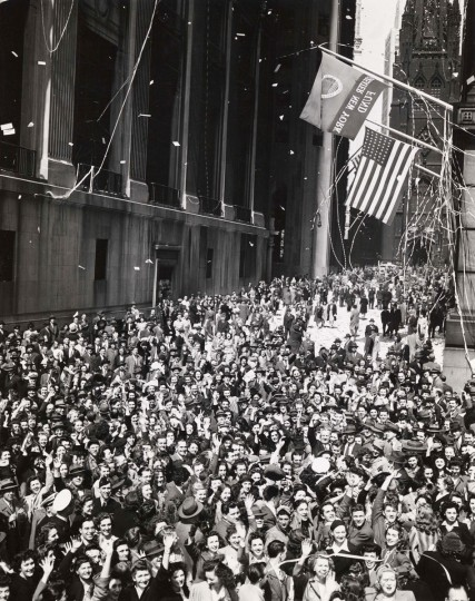 """This May, 1945 photo """"V-E Day"""" of a crowd on Wall Street by Weegee was provided by the International Center of Photography in New York. (AP Photo/Copyright Weegee/The International Center of Photography)"""