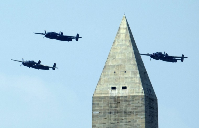 The North American B-25 Mitchell bombers, fly the Doolittle Raid formation during a flyover over near the Washington Monument over Washington, Friday, May 8, 2015. The World War II vintage aircrafts were marking the 70th anniversary of the end of the war in Europe on May 8, 1945, and commemorate the Allied victory in Europe during World War II. (AP Photo/Manuel Balce Ceneta)