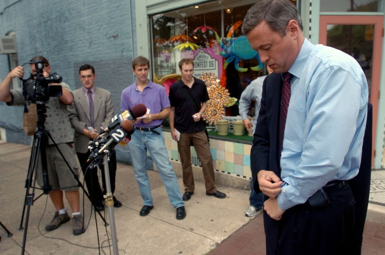 Mayor Martin O'Malley buttons his shirtsleeves as he puts on his jacket before a media event about the campaign for governor the day after Montgomery County Executive Douglas Duncan withdrew from the race. O'Malley is on a street corner in Hampden. (Kim Hairston, Baltimore Sun)