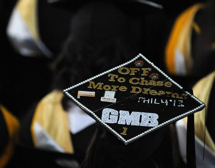 DREAM CATCHER - On Commencement Day, Towson University graduates express their creativity by decorating their mortarboards with messages of thanks to parents, friends, the Almighty, and even coffee. (Algerina Perna/Baltimore Sun)