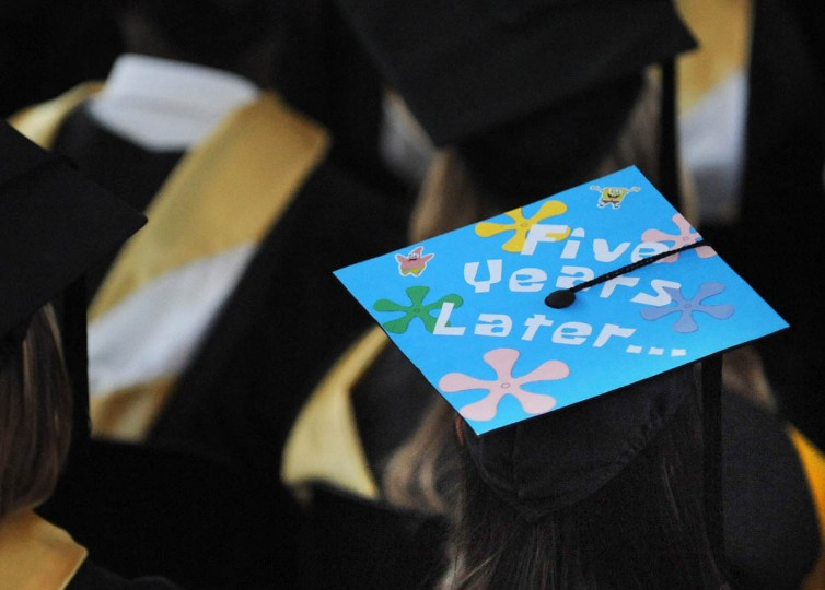 FLOWER POWER - On Commencement Day, Towson University graduates express their creativity by decorating their mortarboards with messages of thanks to parents, friends, the Almighty, and even coffee. (Algerina Perna/Baltimore Sun)