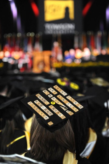 SCRABBLE, ANYONE? - On Commencement Day, Towson University graduates express their creativity by decorating their mortarboards with messages of thanks to parents, friends, the Almighty, and even coffee. (Algerina Perna/Baltimore Sun)