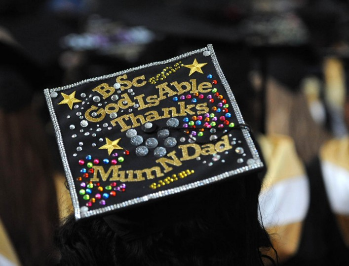 GRATITUDE - On Commencement Day, Towson University graduates express their creativity by decorating their mortarboards with messages of thanks to parents, friends, the Almighty, and even coffee. (Algerina Perna/Baltimore Sun)