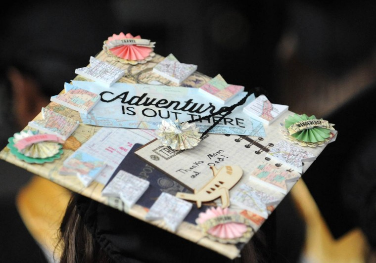 THE WORLD IS YOUR OYSTER - On Commencement Day, Towson University graduates express their creativity by decorating their mortarboards with messages of thanks to parents, friends, the Almighty, and even coffee. (Algerina Perna/Baltimore Sun)