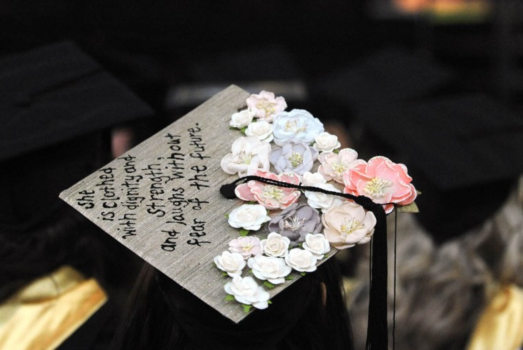 FEMININITY, GRACE AND STRENGTH - On Commencement Day, Towson University graduates express their creativity by decorating their mortarboards with messages of thanks to parents, friends, the Almighty, and even coffee. (Algerina Perna/Baltimore Sun)