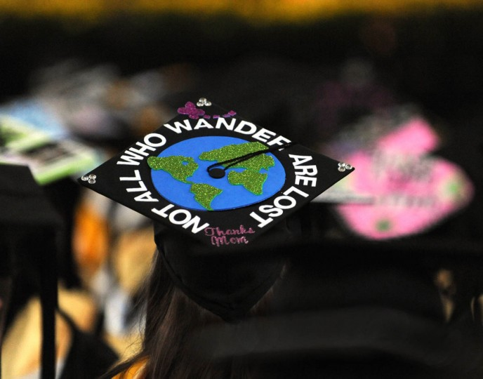 THE LONG WAY - On Commencement Day, Towson University graduates express their creativity by decorating their mortarboards with messages of thanks to parents, friends, the Almighty, and even coffee. (Algerina Perna/Baltimore Sun)