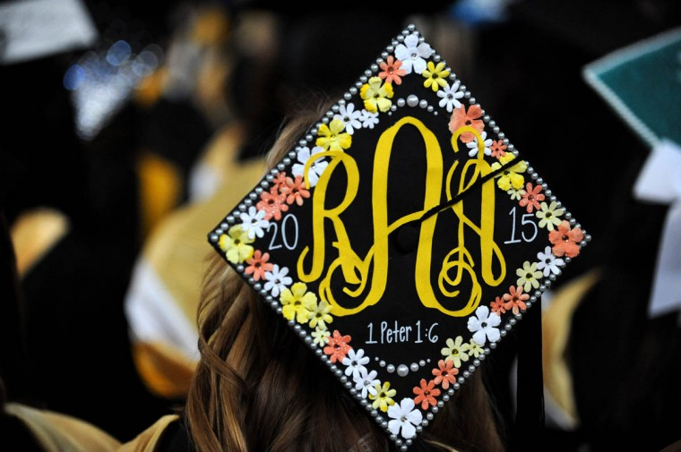 JOY AND SUFFERING - On Commencement Day, Towson University graduates express their creativity by decorating their mortarboards with messages of thanks to parents, friends, the Almighty, and even coffee. (Algerina Perna/Baltimore Sun)